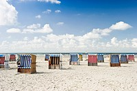 Roofed wicker beach chairs on the beach of St. Peter_Ording, North Frisia, Schleswig_Holstein, Germany, Europe