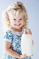 little girl holding a jug of milk