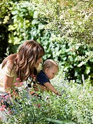 mother and baby son in the garden