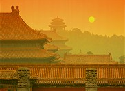 Rooftops of Asian buildings at sunset