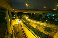 Modern Urban City with Freeway Traffic at Night