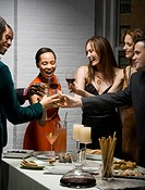 Group of people toasting glasses at a party
