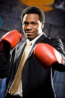 Portrait of a businessman boxing