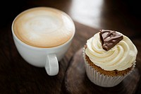 Cup of coffee and a chocolate cupcake