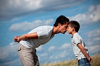 Father and son in a field showing affection