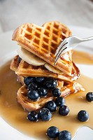 Waffels with golden syrup and blue berries