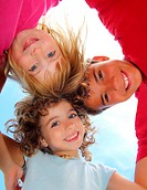 Below view of happy three children embracing