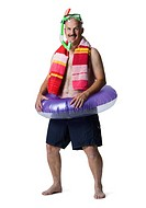 WR0888699 Portrait of a man standing with an inflatable ring around his waist
