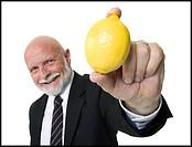 Portrait of a businessman showing a lemon
