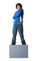 Portrait of a teenage boy standing on a blank sign