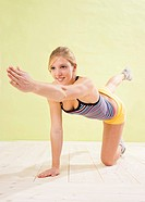 Young woman doing strengthening exercises