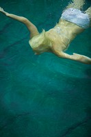 High angle view of a young woman swimming
