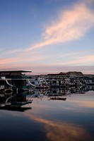 Panoramic view of boathouses in a row