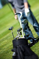Close_up of golf clubs in a golf bag