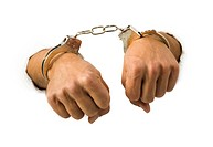 Close_up of hands in handcuffs