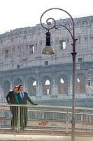 Couple in front of the Roman Colosseum Rome Italy