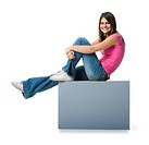 Profile of a teenage girl relaxing on a blank sign and smiling