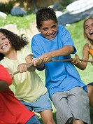 Children pulling the rope and smiling
