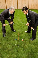 High angle view of two businessmen playing croquet