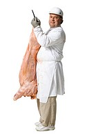 Butcher standing with hanging carcass