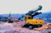 Heavy equipment working in a log yard