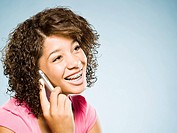 WR0899744 Girl with braces talking on cell phone smiling