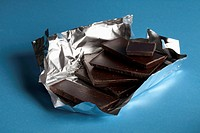 A stack of chocolate in foil packaging