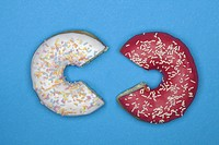 Two donuts with missing pieces