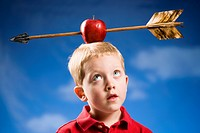 Boy with apple and arrow on head