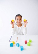 Girl holding alphabet blocks
