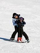Woman and young girl skiing