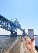 Tokyo Gate Bridge and a smartphone