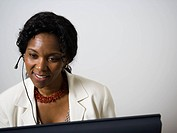Close_up of a businesswoman using a computer and smiling
