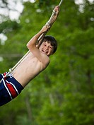 WR0905731 Portrait of a boy swinging on a rope