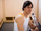 Portrait of a young man holding a water bottle