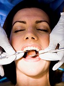 Woman having dental examination
