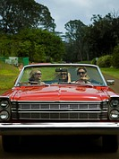 Three young women traveling in a car
