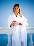 Woman in housecoat relaxing outdoors