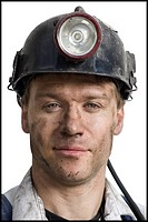 Miner with flashlight helmet