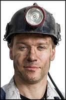 Miner with flashlight helmet