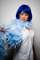 Man in blue wig and feather boa flirting