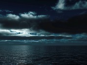 thunderclouds above the marine waves of turquoise