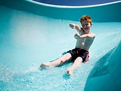 WR0913899 Boy on a waterslide