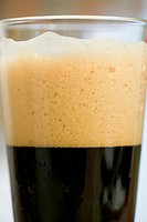 Close up of a glass of dark beer
