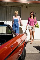 two women leaving a motel.
