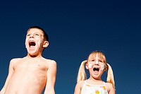 Boy and girl with sunscreen shouting