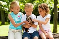 Three children with small dog