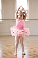 Girl 2_3 practicing ballet in studio