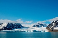 Beautiful Monacobreen glacier in Liefdefjorden, northwest coast of Svalbard, Norway, in summertime.