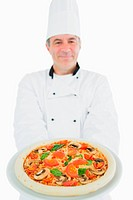 Chef holding delicious pizza